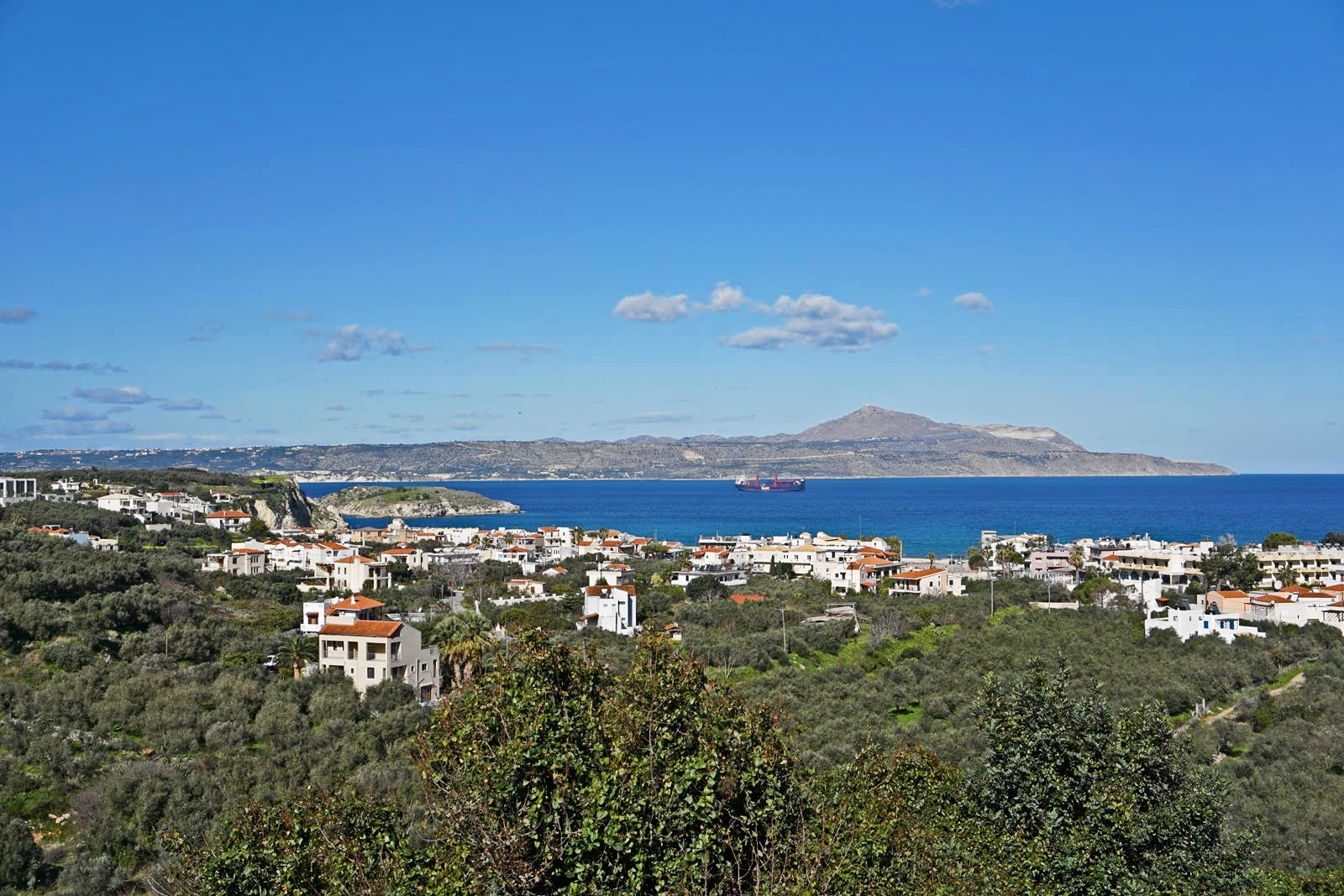 Large plot with panoramic sea and White Mountains views in Almyrida